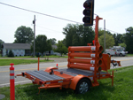 portable traffic signal and portable traffic light in use
